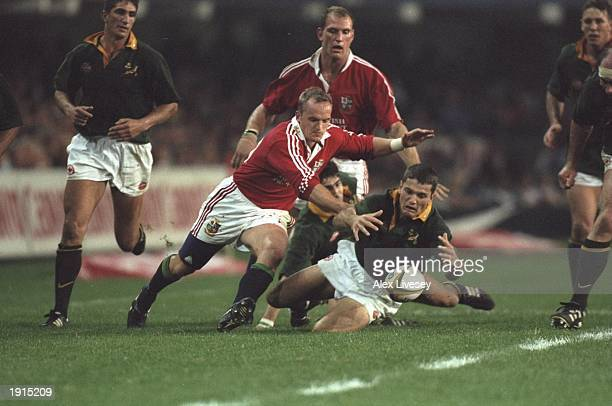 Gregor Townsend of the British Lions and Van Der Westhuizen of South Africa pounce for the loose ball during the second test match against South...