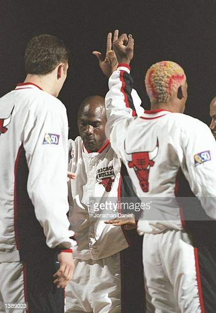 Guard Michael Jordan center Luc Longley forward Dennis Rodman and guard Ron Harper of the Chicago Bulls huddle up before a game against the Utah Jazz...