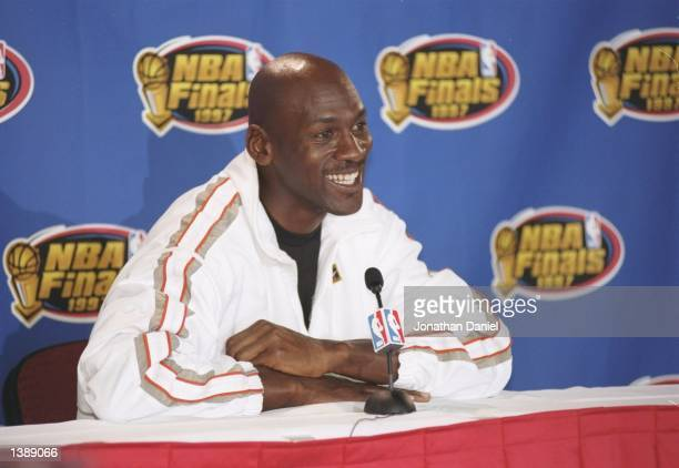 Guard Michael Jordan of the Chicago Bulls speaks to reporters during a press conference at the United Center in Chicago, Illinois. Mandatory Credit:...