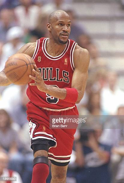 Guard Ron Harper of the Chicago Bulls dribbles the ball down the court during a playoff game against the Utah Jazz at the Delta Center in Salt Lake...