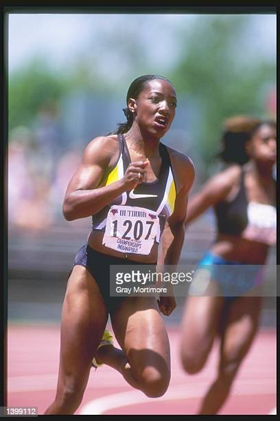 Inger Miller runs around the track during the 200 meter semifinals at the US Outdoor Track and Field Championships in Indianapolis Indiana Mandatory...