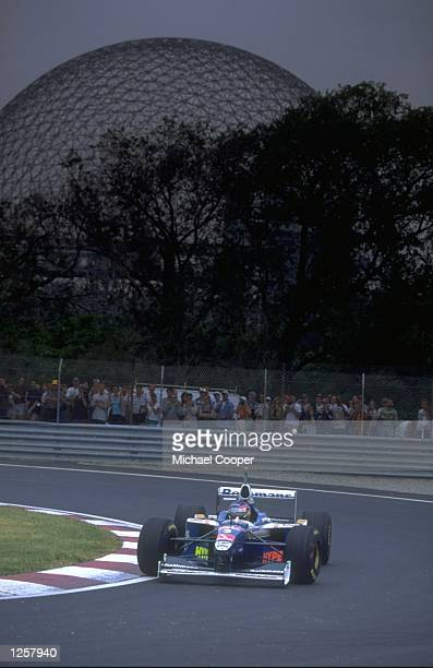 Jacques Villeneuve of Canada cuts close to a corner in his WilliamsRenault during the Canadian Grand Prix at the Circuit Gilles Villeneuve in...