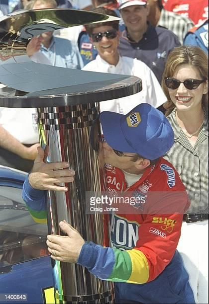 Jeff Gordon kisses his trophy after winning the California 500 at the California Speedway in Fontana, California. Mandatory Credit: Craig Jones...