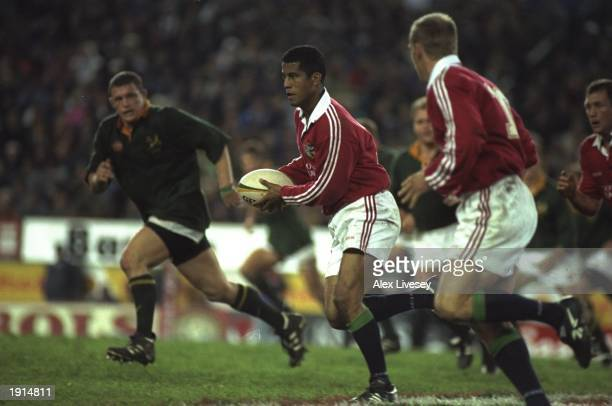 Jeremy Guscott of the British Lions breaks free with team mate Gregor Townsend in support during the first test against South Africa at Newlands in...