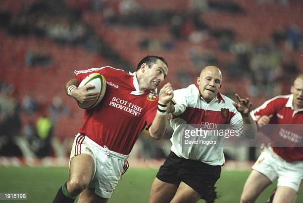 John Bentley of the British Lions sprints past the defence to score a try during the tour match against Gauteng at Ellis Park in Johannesburg South...