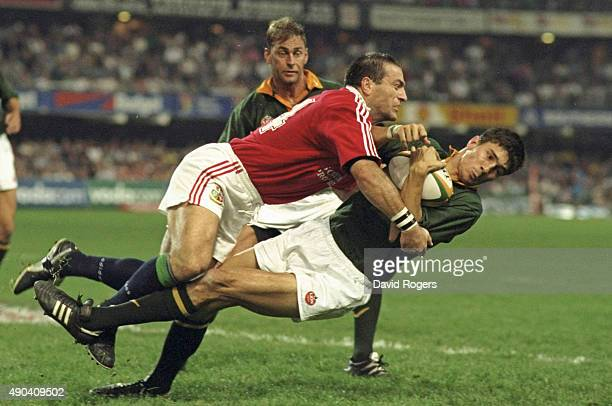 John Bentley of the British Lions tackles Pieter Rossouw of South Africa during the second test match at Kings Park in Durban South Africa The...