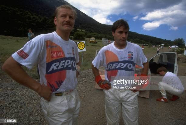 Juha Kankkunen of Finland and Carlos Sainz of Spain assess their situations in the mountains of the Acropolis Rally during the FIA World Rally...