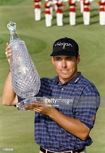 Justin Leonard displays the trophy during the Kemper Open at the TPC at Avenel in Potomac, Maryland.