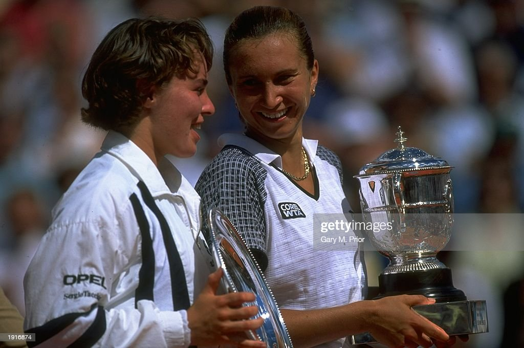 Martina Hingis (left) of Switzerland and Iva Majoli (right) of Croatia hold their respective trophies after the Women's Singles final during the French Open at Roland Garros in Paris. Majoli won the match in straight sets 6-4, 6-2. \ Mandatory Credit: Gary M Prior/Allsport