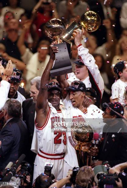 Michael Jordan and Scottie Pippen of the Chicago Bulls celebrate with the trophy after winning game 6 of the 1997 NBA Finals at the United Center in...