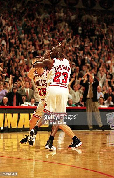 Michael Jordan of the Chicago Bulls celebrates with teammates Steve Kerr during game six of the NBA Final against the Utah Jazz at the United Center...