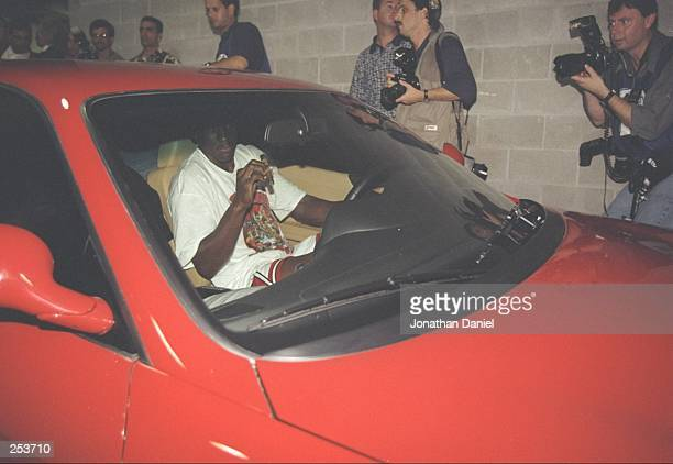 Michael Jordan of the Chicago Bulls leaves the stadium in his Ferrari after the Bulls win game 6 of the 1997 NBA Finals at the United Center in...