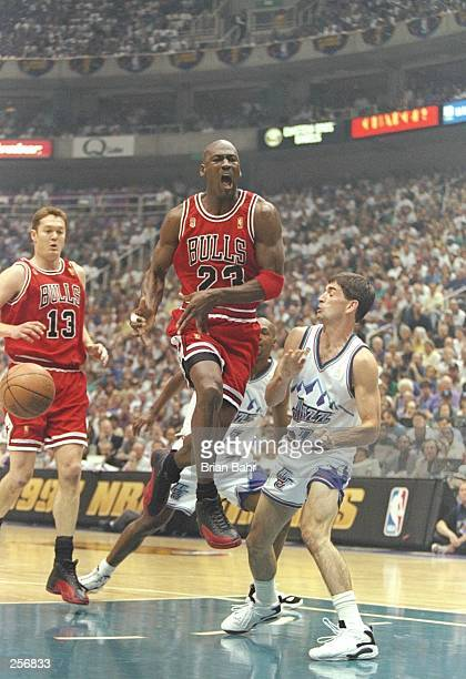 Michael Jordan of the Chicago Bulls passes the ball while defended by John Stockton of the Jazz during the Bulls 9088 win over the Utah Jazz in Game...