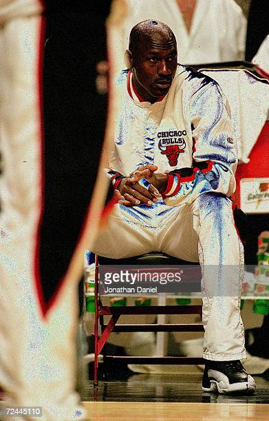 Michael Jordan of the Chicago Bulls sits on the bench during game six of the NBA Final against the Utah Jazz at the United Center in Chicago Illinois...