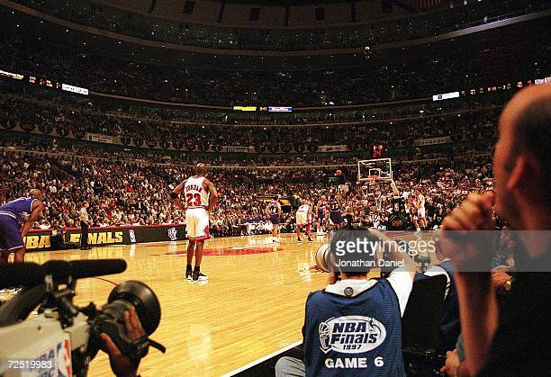 Michael Jordan of the Chicago Bulls stands on the court during game six of the NBA Final against the Utah Jazz at the United Center in Chicago...