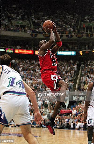 Michael Jordan of the Chicago Bulls takes a shot at the basket during game five of the NBA Finals against the Utah Jazz at the Delta Center in Salt...