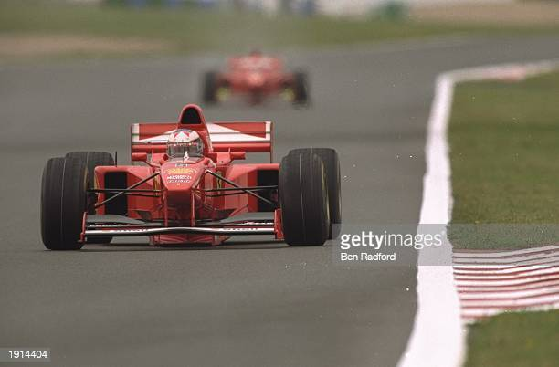 Michael Schumacher of Germany leads Eddie Irvine of Ireland both of the Ferrari team during the French Grand Prix at Magny Cours France Schumacher...