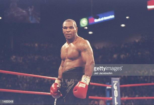 Mike Tyson looks on during a bout against Evander Holyfield at the MGM Grand Garden in Las Vegas, Nevada. Holyfield won the fight with a...