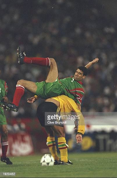 Noureddine Naybet of Morocco and Kim Tyrone Grant of Ghana clash with each other during the World Cup qualifying match in Casablanca Morocco Morocco...