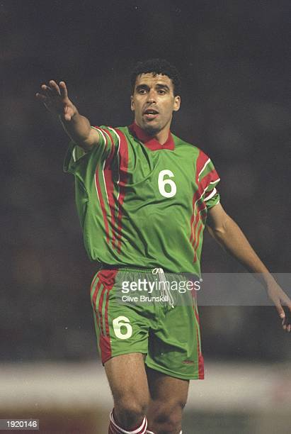 Noureddine Naybet of Morocco signals to his team mates during the World Cup qualifying match against Ghana at the Complexe Sportif Mohamme in...