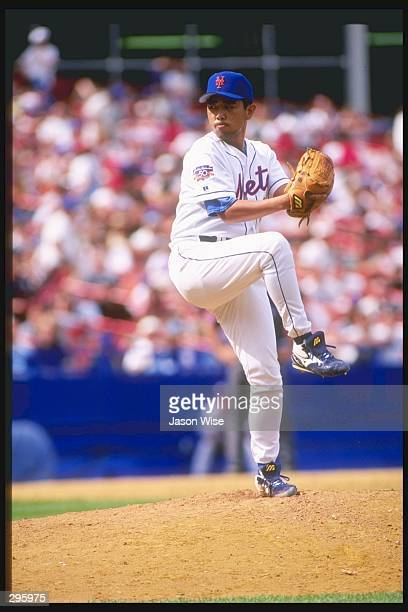 Pitcher Takashi Kashiwada of the New York Mets winds up to throw a pitch during the Mets 85 win over the Philadelphia Phillies at Shea Stadium in...