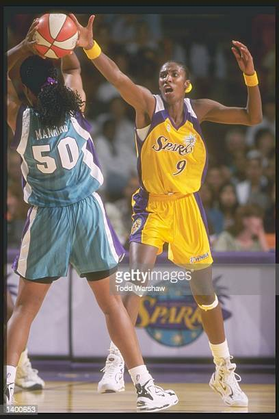 Sharon Manning of the Charlotte Sting tries to fend off Lisa Leslie of the Los Angeles Sparks at the Great Western Forum in Los Angeles California...