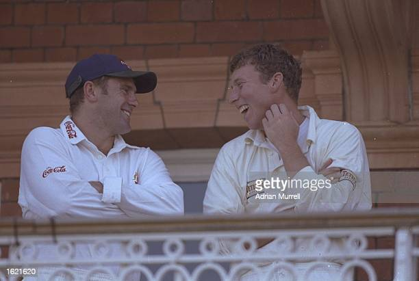 The Ashes captains Mark Taylor of Australia and Mike Atherton of England share a joke on the balcony during the second test match against Australia...
