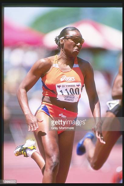 Zundra Feasin runs around the track during the 200 meter dash semifinals at the US Outdoor Track and Field Championships in Indianapolis Indiana...