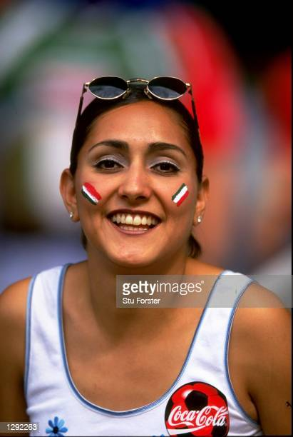 Female fan shows her support during the World Cup group E game between Mexico and South Korea at the Stade Gerland in Lyon, France. Mexico won 3-1. \...