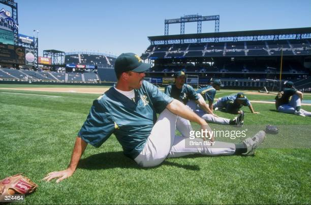 A member of the Oakland Athletics participates in a pre game stretch during an interleague game against the Colorado Rockies at Coors Field in Denver...