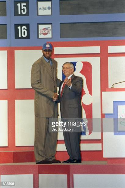 A picture of the 1st Pick Michael Olowokandi by the Los Angeles Clippers shaking hands with David Stern the NBA Commissioner during the NBA Draft at...