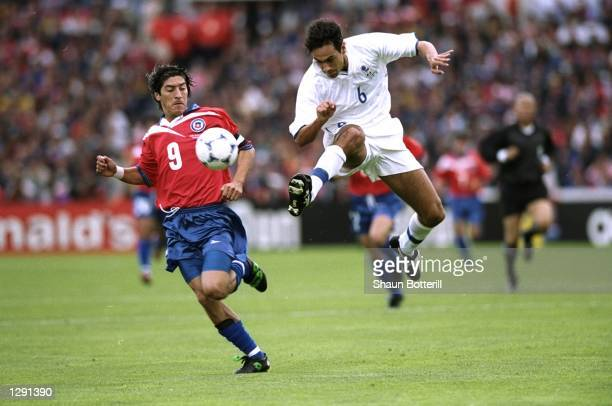 Alessandro Nesta of Italy challenges Ivan Zamorano of Chile during the World Cup group B game at the Parc Lescure in Bordeaux France The match ended...