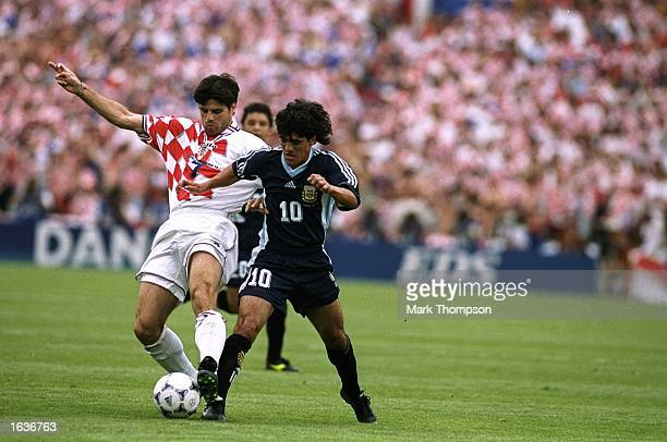 Aljosa Asanovic of Croatia challenges Ariel Ortega of Argentina during the World Cup group H game at the Parc Lescure in Bordeaux France Argentina...