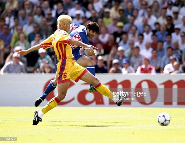 Aljosa Asanovic of Croatia shoots past Gheorghe Popescu of Romania during the World Cup second round match at the Parc Lescure in Bordeaux France...
