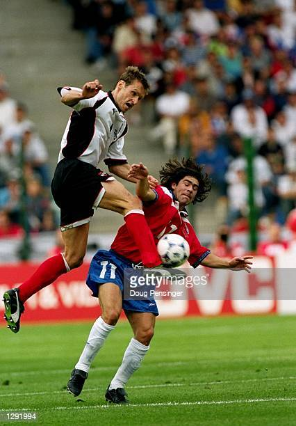 Anton Pfeffer of Austria rises above Marcelo Salas of Chile during the World Cup group B game at the Geoffroy Guichard Stadium in St Etienne France...