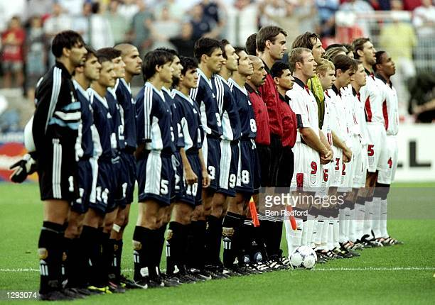 Argentina and England line up for the national anthems before the World Cup second round match at the Stade Geoffroy Guichard in St Etienne France...
