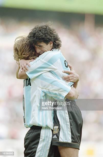 Ariel Ortega of Argentina celebrates with team mate Gabriel Batistuta during the World Cup group F match against Jamaica at the Parc des Princes in...