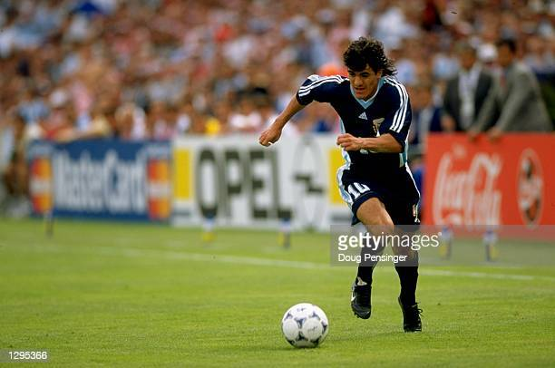 Ariel Ortega of Argentina runs with the ball during the match between Croatia v Argentina in the 1998 World Cup played in Bordeaux France Mandatory...