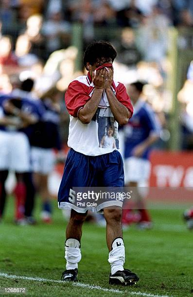 Celso Ayala of Paraguay feels the anguish of going out of the World Cup Finals after the second round match against France at the Stade Felix...