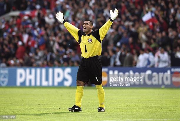 Chile goalkeeper Nelson Tapia celebrates during the World Cup group B game against Italy at the Parc Lescure in Bordeaux France The match ended 22...