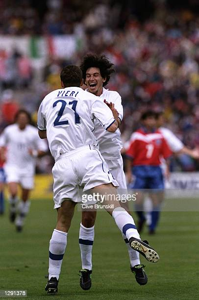 Christian Vieri of Italy celebrates with team mate Demetrio Albertini after scoring the opening goal in the World Cup group B game against Chile at...