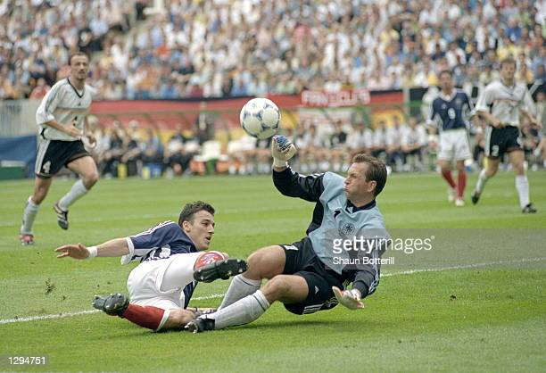 Darko Kovacevic of Yugoslavia goes in on Andreas Kopke of Germany during the World Cup group F game at the Stade Felix Bollaert in Lens France The...