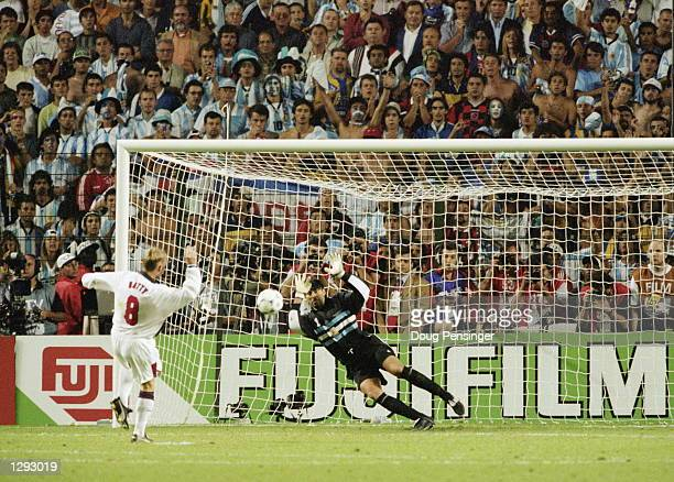 David Batty of England fails to beat Argentina goalkeeper Carlos Roa during the penalty shootout in the World Cup second round match at the Stade...