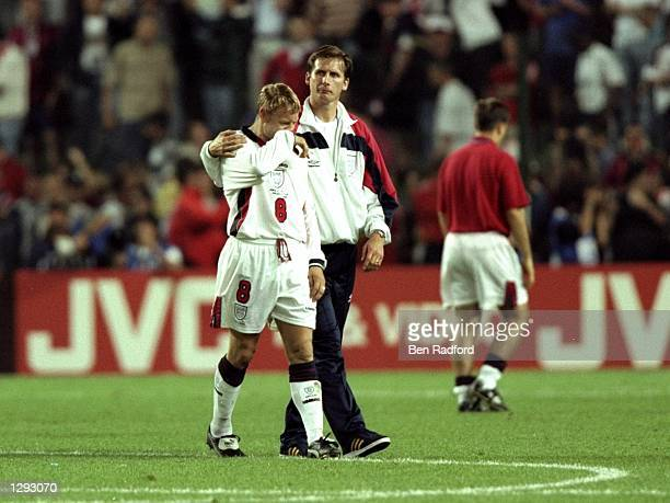 David Batty of England is consoled by coach Glenn Roeder after failing to convert the crucial sportkick in the penalty shootout of the World Cup...