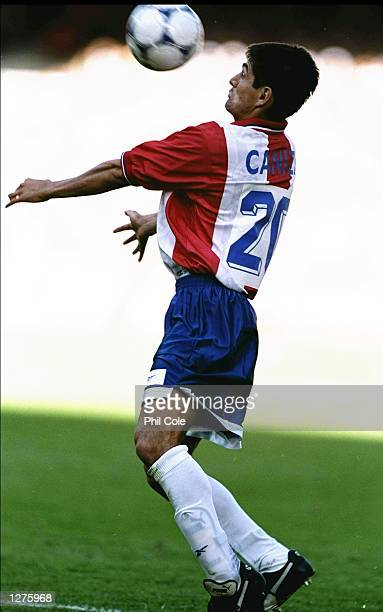 Denis Caniza of Paraguay in action during the World Cup second round match against France at the Felix Bollaert Stadium in Lens France France won the...