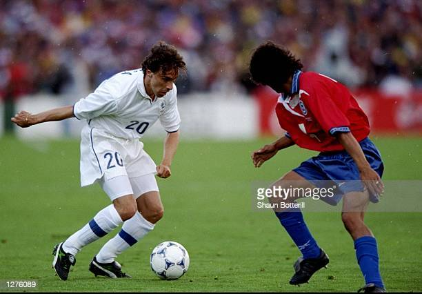 Enrico Chiesa of Italy takes on a Chilean defender during the World Cup first round match at the Parc Lescure in Bordeaux France The match ended in a...