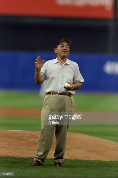 Former Yankee Yogi Berra throws the first pitch to start the interleague game between the New York Mets and the New York Yankees at Shea Stadium in...