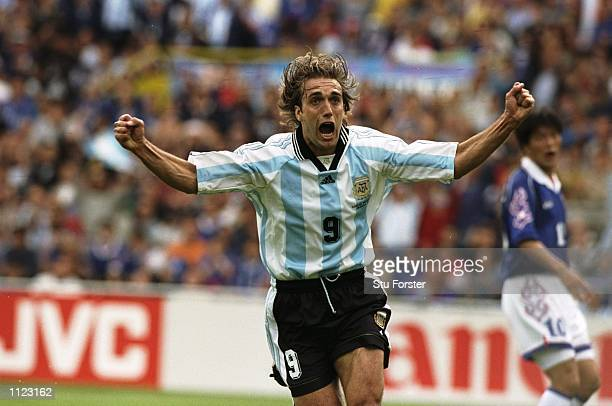 Gabriel Batistuta of Argentina celebrates after scoring in the World Cup group H game against Japan at the Stade Municipal in Toulouse, France....
