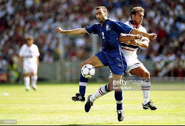 Giuseppe Bergomi of Italy holds off Havard Flo of Norway during the World Cup second round match at the Stade Velodrome in Marseille France Italy won...