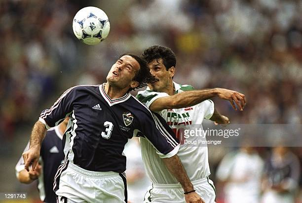 Goran Djorovic of Yugoslavia challenges Ali Daei of Iran in the air during the World Cup group F game at the Geoffroy Guichard Stadium in St Etienne...